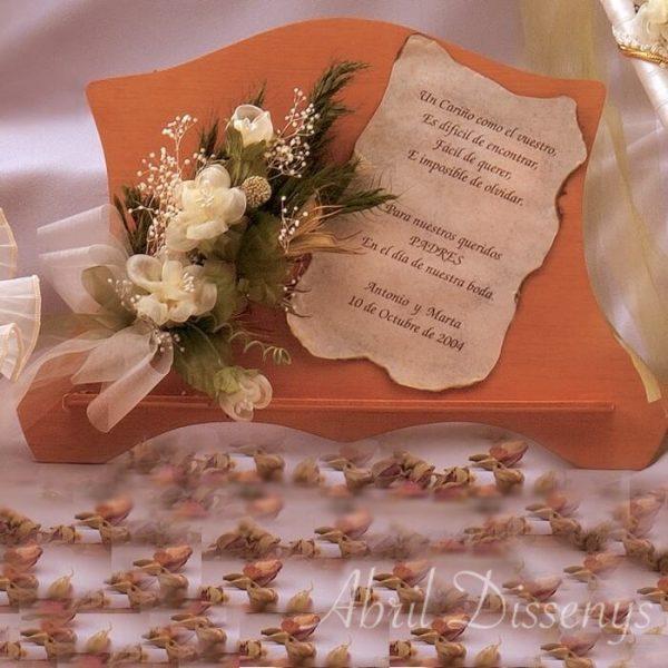 Atril con dedicatoria y flores con sentimiento