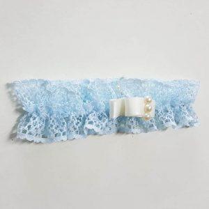 Liga azul con lazo y perlas cava