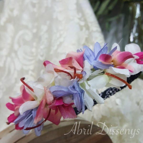 Diadema con flor lateral noches de Eva