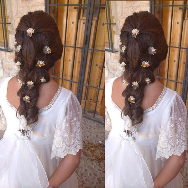 Pin de flores sueltas para el pelo
